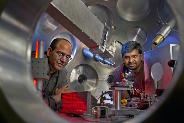 Sasi Palaniyappan, right, and Rahul Shah inside a target chamber where the TRIDENT short pulse laser is aimed at a very thin foil target.