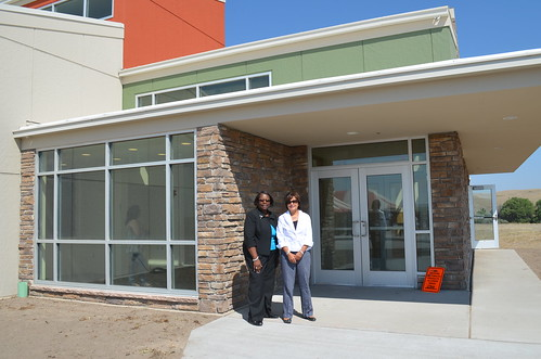 (Left to right) is Sandra Henriquez, Assistant Secretary for Housing and Urban Development's (HUD) Public and Indian Housing and USDA Rural Development State Director, Elsie M. Meeks stand together in front of the newly constructed Oglala Sioux Lakota Housing Authority administration building.