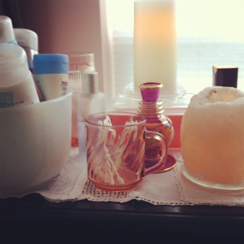 I use thrifted vintage #kitchenware in my bathroom as containers.  Pink #pyrex pink #depressionglass. #glas-bake