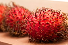 plant(0.0), rambutan(1.0), red(1.0), produce(1.0), fruit(1.0), food(1.0),