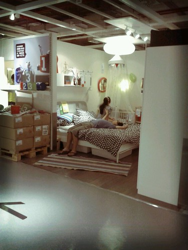 Testing the bed at Ikea Beijing