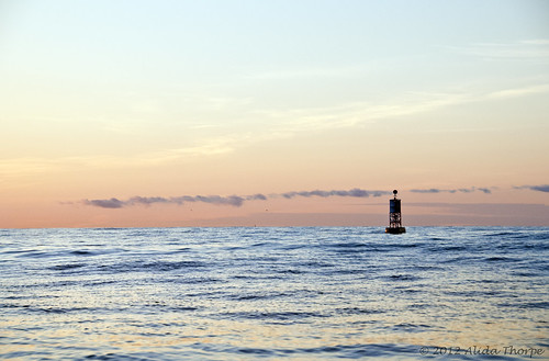 Ocean Buoy at sunrise by Alida's Photos