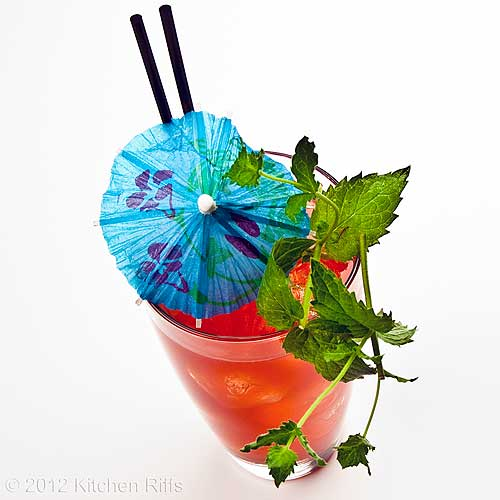 Zombie Cocktail with Mint Sprig and Umbrella Garnish, White Background
