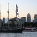 A tall ship passes Canary Wharf