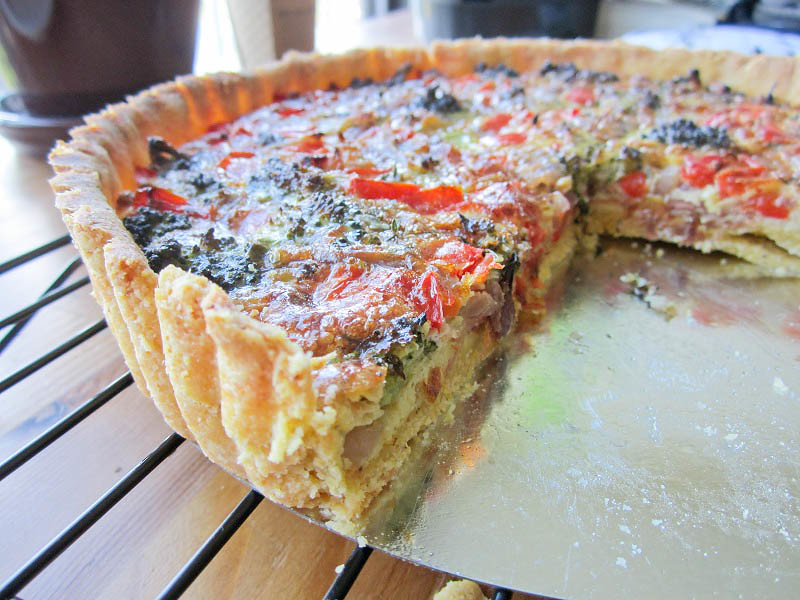 Quiche with bacon, red peppers, broccoli, and Gruyere