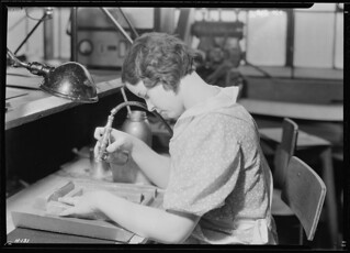 Ruby Hilton, Lynn Gardens, Kingsport, Tennessee. Another view of the super-finish operation calling for the spraying of gold with an air gun, November 1933