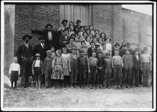 The whole force in Elk Cotton Mills. Tiny boy in white waist on extreme left, Just helps mother. The supt. Said, next boy is Leo, with a steady job, November 1910