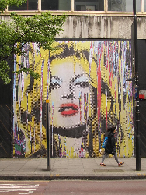 Mr Brainwash on the corner of New Oxford Street and Museum Street, London
