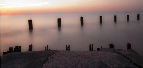 longexposure morning chicago rock skyline sunrise canon dawn illinois lakemichigan lakeshoredrive silence wakingup chicagoist canonrebelt1i lakemichigancoastline fullertonpier
