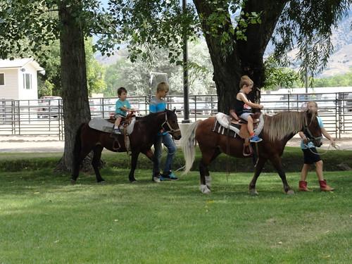 Olsen and Ben riding ponies
