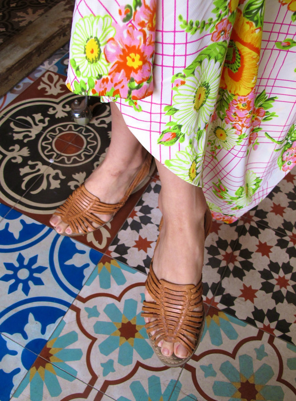 An explosion of colours! Brown peekaboo leather sandals peek out from underneath a bright hem.