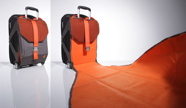 Suitcase with attached blanket