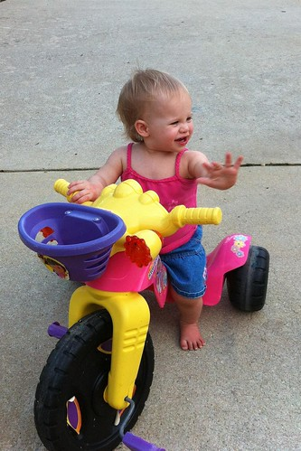 Lucy taking the big wheel for a test spin.