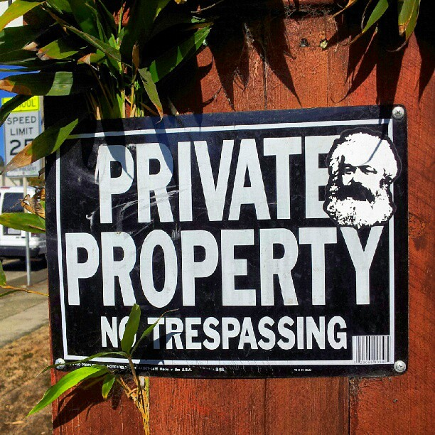 Private property sign with Karl Marx image