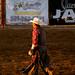 cowboy walking towards the sunset