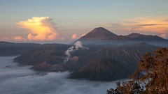 Mount Bromo smoulders with Semeru overlooking in the background at sunrise.