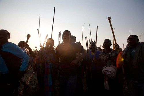 South African workers armed with traditional weapons are in a dispute over union representation and salaries. Police opened fire on strikers resulting in over 30 reported deaths. by Pan-African News Wire File Photos