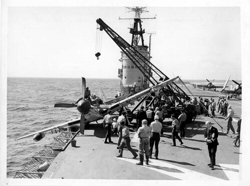 Flight deck HMAS SYDNEY with a damaged Fairey Firefly