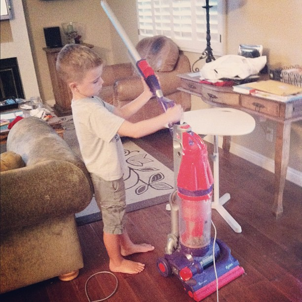 He wanted to learn how to vaccuum tonight. The main reason, to get vaccuum lines on the carpeting in his room.