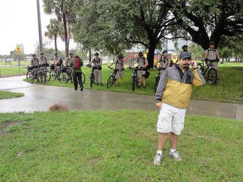 Police officers on bicycles watch Coalition March on RNC