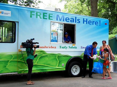 Northeast Regional Administrator, James Arena-DeRosa serves a meal from the NYC food truck at Orchard Beach in the Bronx.