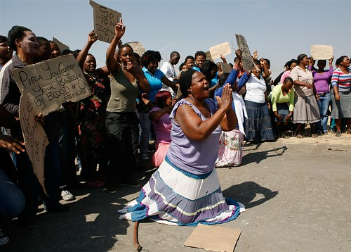 Women protest around the Marikana platinum mines area where over 40 people were killed in a week of labor unrest. The South African government has ordered a commission of inquiry to find out the truth of what happened. by Pan-African News Wire File Photos