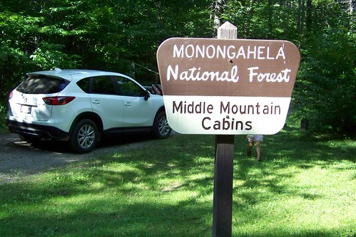 Middle Mountain Cabins sign
