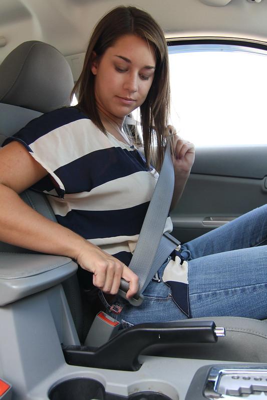 Female Teen Driver Buckling Her Seatbelt