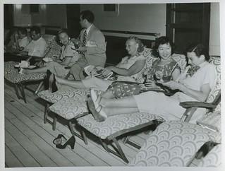 Passengers on the promenade deck of RMS CARONIA