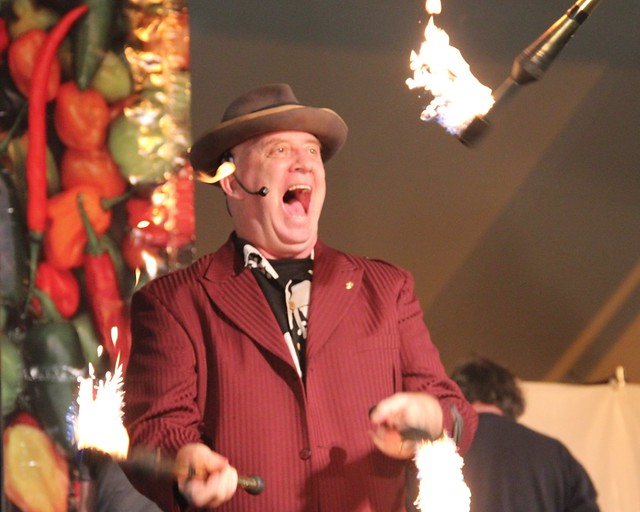 MC Stephen Ringold juggling fire at the Chile Pepper Fiesta. Photo by Rebecca Bullene.