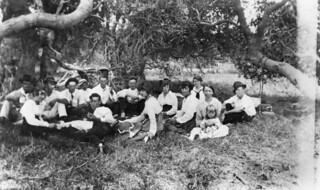 Group of people enjoying a picnic under the trees at Christmas, Moreton Island, 1919