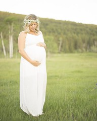Those golden moments of summer, a maternity shoot! Left wandering the golden pastures of the Valleyview farm, matched in white and crowned in floral.     Their dog, big ol' goofy Jewels, didn't quite understand what was going on the whole time. She would