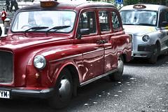 compact car(0.0), automobile(1.0), vehicle(1.0), austin fx4(1.0), city car(1.0), antique car(1.0), sedan(1.0), vintage car(1.0), land vehicle(1.0), luxury vehicle(1.0), motor vehicle(1.0),
