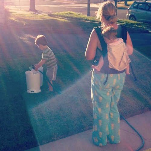 Between my pajama / baby wearin' supervision of Charlie hosing out a poop bucket (diaper genie) in the front yard ...