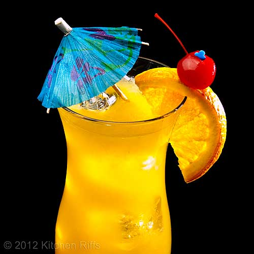 Fog Cutter Cocktail with Orange and Maraschino Cherry Garnish, and Umbrella