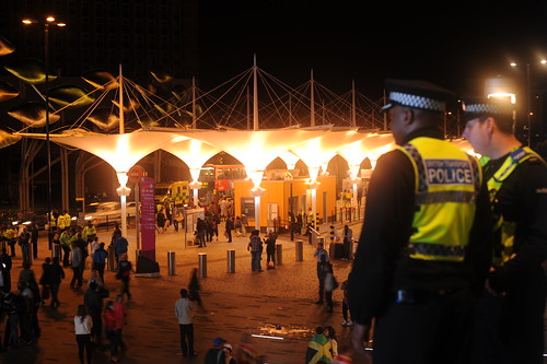 Officers survey the scene outside Stratford station as crowds disperse
