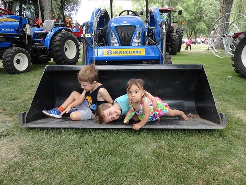 Olsen, Ben, and Jovie in the tractor shovel