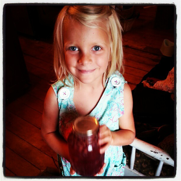 Ella and a quart of grape juice she made.