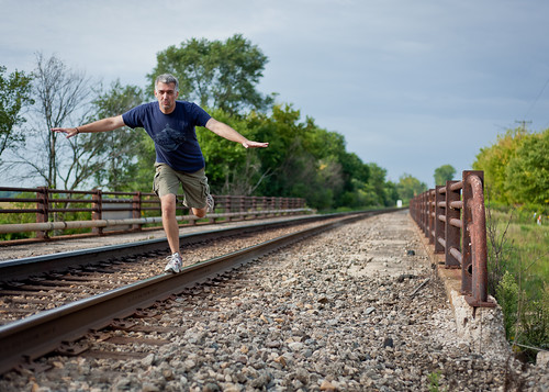 picture of self assuming dangerously cliche pose atop railroad tracks