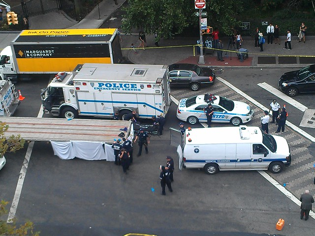 Aerial view of fatal accident investigation on Sixth Ave