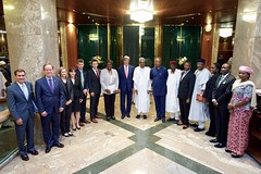 U.S. Secretary of State John Kerry is joined by Assistant Secretary of State for African Affairs Linda Thomas-Greenfield, U.S. Embassy Abuja Deputy Chief of Mission David Young, and other advisers on August 23, 2016, as they pose for a group photo at the Presidential Villa in Abuja, Nigeria, following a bilateral meeting Nigerian President Muhummadu Buhari and his team. [State Department Photo/ Public Domain]