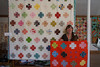 Susan Beal with two modern crosses quilts by hollybroadland