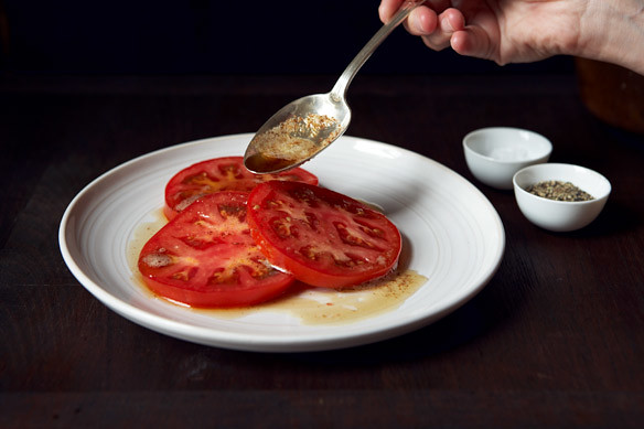 Spooning butter on tomatoes