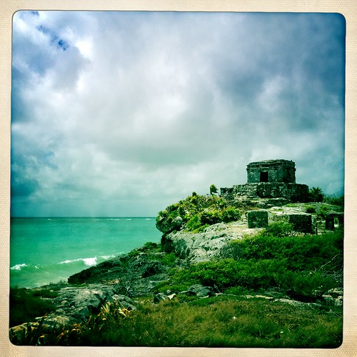 Mayan ruins at Tulum in Mexico, overlooking the crashing azure waves of the Caribbean Sea