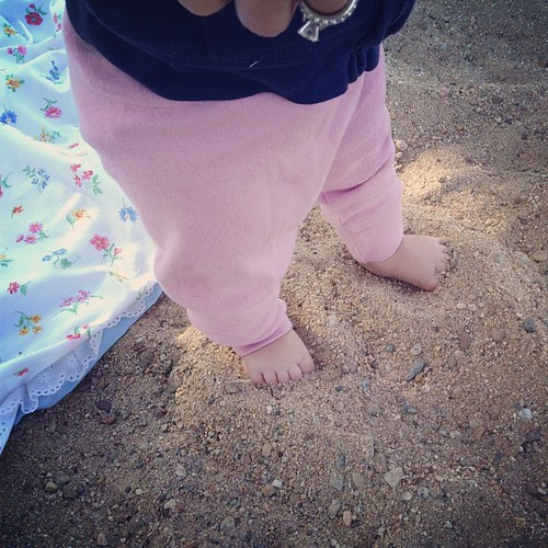 First time sticking her toes in the sand.