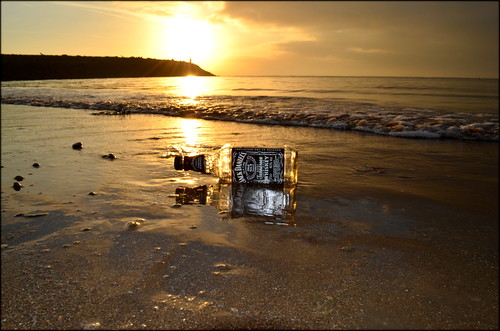 uk morning light sea lighthouse reflection beach wales sunrise landscape dawn bottle sand experimental waves creative cardiff whiskey spirits shore barry jd sunrays jackdaniels barryisland alcahol jacksonsbay