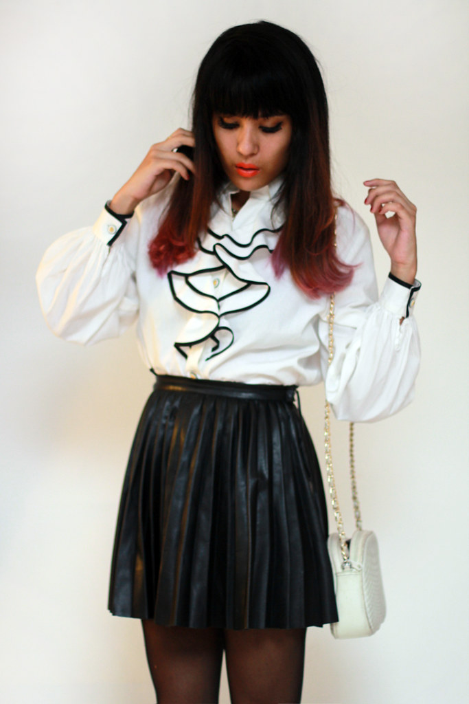 Tarte Vintage via shoptarte.com: ruffles blouse and pleather pleated skirt
