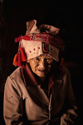 "old woman from the ""flower waist"" Yi people"