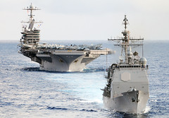 USS Mobile Bay (CG 53) and the aircraft carrier USS John C. Stennis (CVN 74) transit the Pacific Ocean with USS George Washington (CVN 73) after completing exercise Valiant Shield 2012 in September. (U.S. Navy photo by Mass Communication Specialist 3rd Class Stephanie Smith)