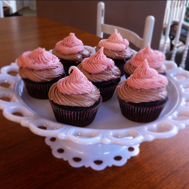 Strawberry Nutella cupcakes ready for a baby shower.